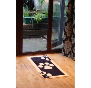 Barrier rugs black with big paws